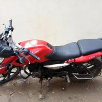 bajaj pulser 135 red