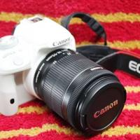 canon 100D white body with 18-55 lens